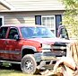 """A Georgia man says he was so angry after a phone call with his wife that he drove his truck through his house.  John Paul Jones, Jr., 35, of Senoia, says he fully intended to drive his truck from the backyard to the front yard by way of his living room on Thursday.  The Newnan Times-Herald reported that Jones told authorities he'd been frustrated because he hadn't been able to sell his home, but Jones told WGCL that the incident was """"just one of those spur of the moment crazy things.""""  Jones, who works as a contractor, did his own repairs. He appeared in good spirits when WGCL interviewed him on Sunday.  """"I've been out of work for the past year and a half. Needed some work,"""" Jones told WGCL. """"It didn't pay anything, but hey, it kept me busy.""""  Neighbors heard a ruckus around 4:40 Thursday afternoon and called police. Coweta County deputies met Jones outside the house, where the truck was parked with furniture caught in the bumper.  """"The police came out here, I told them I needed air c"""