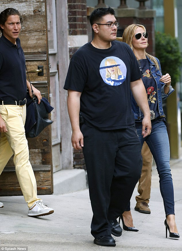 Differing looks: Heidi may have been entirely casual - other than her shoes - but Vito looked rather like he was heading to a golf course in a polo shirt and trousers