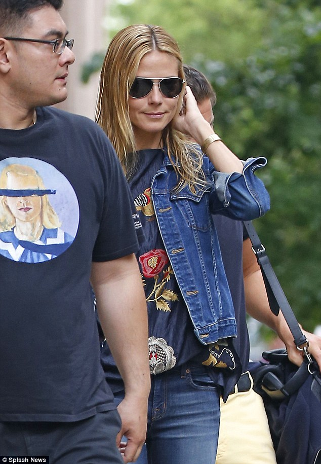 Spring stroll: Heidi Klum and boyfriend Vito Schnabel went for a walk on Sunday, leaving from their New York City apartment