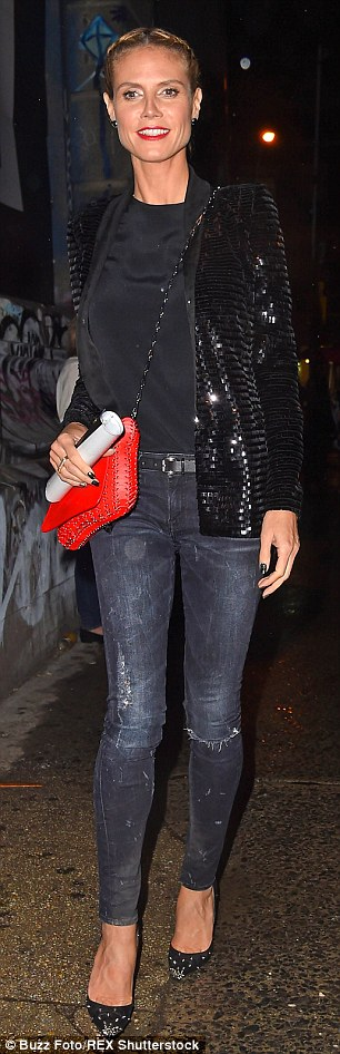 Off she goes! The model's distressed jeans hugged her long catwalk legs