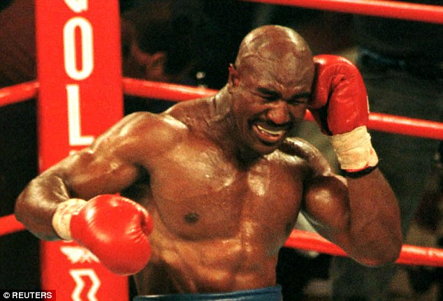 Holyfield reacts after Tyson bit his ear during the third round of their heavyweight fight in Las Vegas