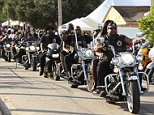A motorcycle club on cruisers drives into town at the 2012 Atlantic Beach Bikefest in Atlantic Beach, South Carolina in this May 25, 2012 file photo. As bikers roll into coastal South Carolina for an annual Memorial Day weekend motorcyle rally, they will be greeted by a police force that has been tripled in size to handle the event marred last year by shootings that left several dead and others wounded.    REUTERS/Randall Hill/Files