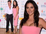 Mandatory Credit: Photo by Ray Tang/REX Shutterstock (4786549ag)  Simon Cowell and Lauren Silverman  Simon Cowell hosts Afternoon Tea at The Dorchester in aid of Shooting Star Chase, London, Britain - 22 May 2015