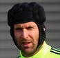 Petr Cech looks on during a Chelsea training session ahead of the UEFA Champions League Round of 16 second leg match against Paris Saint-Germain at Chelsea Training Ground in Cobham, England.     COBHAM, ENGLAND - MARCH 10:   (Photo by Paul Gilham/Getty Images)