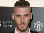 Manchester United's Spanish goalkeeper David de Gea poses for pictures on the red carpet as he arrives to attend the 'Manchester United Player of the Year Awards' at Old Trafford stadium in Manchester, northern England, on May 19, 2015. AFP PHOTO / OLI SCARFFOLI SCARFF/AFP/Getty Images