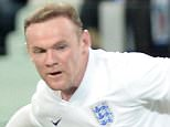England's Wayne Rooney kicks the ball during the international friendly soccer match between Italy and England (1-1), at the Juventus stadium in Turin, Italy, Tuesday, March 31, 2015. (AP Photo/Massimo Pinca)