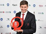 LIVERPOOL, ENGLAND - MAY 19:  (THE SUN OUT, THE SUN ON SUNDAY OUT) Steven Gerrard of Liverpool poses for a photograph after winning the Outstanding Achievement Award during the Liverpool Player of the Year Awards on May 19, 2015 in Liverpool, England.  (Photo by Andrew Powell/Liverpool FC via Getty Images)