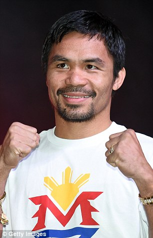 Manny Pacquiao poses during a fan rally at the Mandalay Bay Convention Center