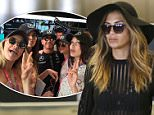 EXCLUSIVE: Nicole Scherzinger wears pajamas and a see through & open-backed blouse revealing her bra & her bare back.  The former member of The Pussycat Dolls who's newly single was seen at LAX looking tense as she attempts to locate her lost luggage while dealing with the luggage office at LAX.\n\nPictured: Nicole Scherzinger\nRef: SPL1035004  230515   EXCLUSIVE\nPicture by: Sharky / Splash News\n\nSplash News and Pictures\nLos Angeles: 310-821-2666\nNew York: 212-619-2666\nLondon: 870-934-2666\nphotodesk@splashnews.com\n