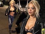 Picture Shows: Rita Ora  May 20th, 2015\n \n ** Video Also Available **\n \n ** No Web / Online Until After 4pm GMT Sunday 24th **\n \n ** Fee For Set After 4pm £500 **\n \n ** Byline MUST read Rex/FameFlynet **\n \n British pop icon Rita Ora is seen filming her new music video outside the Corinthia Hotel in London, England.\n \n Rita shows off her toned abs for the night time shoot while running in her bra and a leather jacket. \n \n The styling for the video appears to be a throwback to the 90's with Rita dressed in baggy ripped denim with a baggy leather jacket. She was also wearing small round sunglasses and had her hair braided to the side. Her hair had been dyed a silver/grey colour for the day shoot and Rita was wearing a David Bowie tour t-shirt.\n \n The video also stars her sister Elena Ora who can be seen in a white dress with badges.\n \n All the girls in the video had slogans written on their clothes.\n \n Rita can be seen aggressively walking into the London traffic and