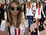 Model Cara Delevingne, center, attends the Formula One Grand Prix, at the Monaco racetrack, in Monaco, Sunday, May 24, 2015. (AP Photo/Luca Bruno)