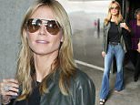 Heidi Klum arriving at LAX on Memorial Day in bell bottom jeans. Heidi Klum says models who turn up to castings in the wrong clothes stand no chance.\nThe German catwalk beauty is certainly the right person to ask for industry advice; she's been in the business since the 90s and regularly passes on her wisdom as mentor on Germany's Next Top Model. May 25 2015 X17online.com