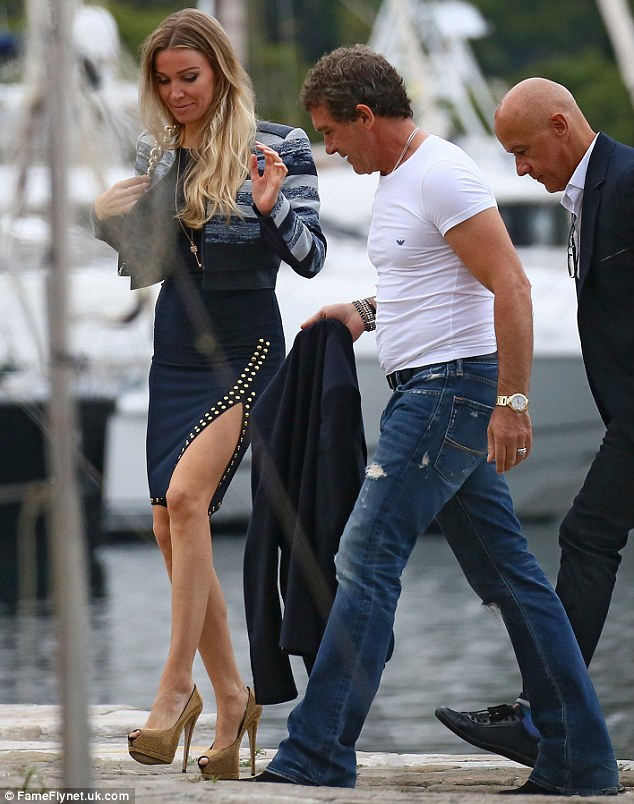 Legs that go on forever: There may be a 20 year age gap, but Antonio Banderas was looking as close as could be to his new girlfriend, Nicole Kimpel, on Friday