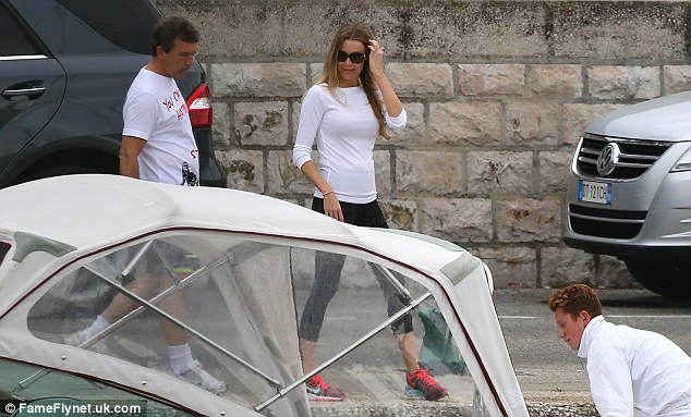 Sports casual:The couple headed out earlier in the day with Antonio wearing a T-shirt emblazoned with the caption 'You can't buy happiness. Steal it'