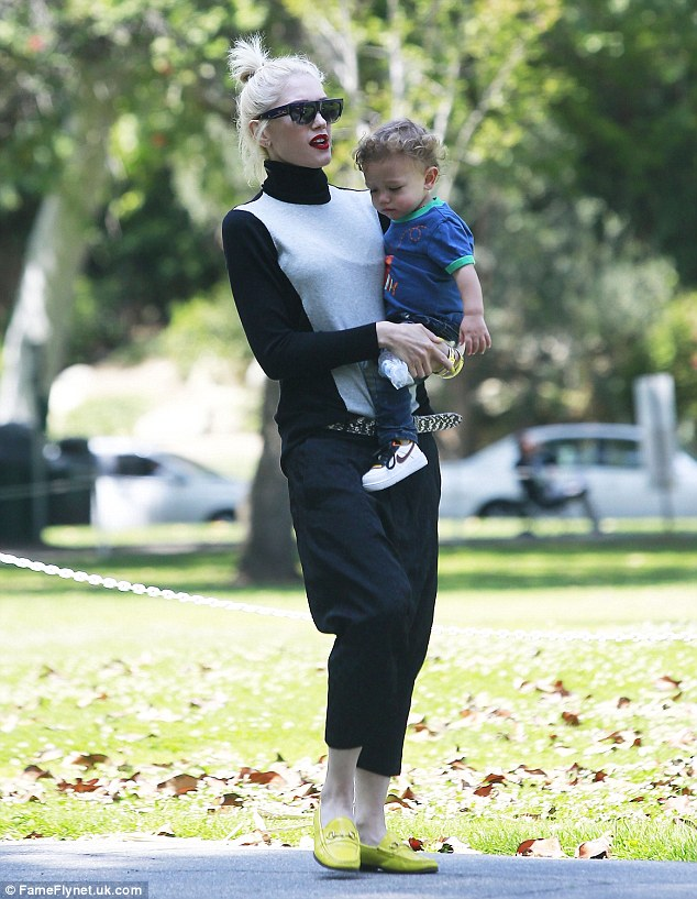 Model mum: Gwen Stefani showed off her impeccable sense of style in harem pants and yellow loafers as she hit the park with her family on Sunday