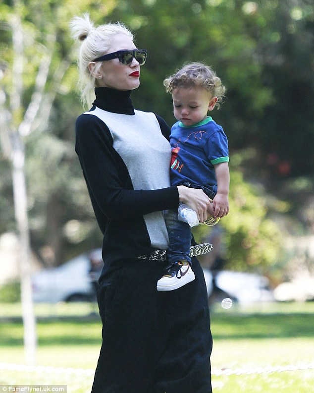 Family time: Gwen carried 14-month-old Apollo around the Beverly Hills sun trap