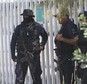Mexican state police stand guard near the entrance of Rancho del Sol, near Vista Hermosa, Mexico, Friday, May 22, 2015. About 40 people were killed Friday in what authorities described as a large-scale shootout between law enforcement and criminal suspects. Almost all the dead were suspected criminals, said a Federal Police official. The confrontation, which occurred near the border of Michoacan and Jalisco states, started when federal police officers tried to pull over a truck on the highway near the ranch. (AP Photo/Refugio Ruiz)