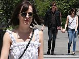 EXCLUSIVE: Dakota Johnston and boyfriend, Matthew Hitt are seen enjoying the sunshine with there dog, Zeppelin, in New York City.\n\nPictured: Dakota Johnston and Matthew Hitt\nRef: SPL1034932  240515   EXCLUSIVE\nPicture by: Splash News\n\nSplash News and Pictures\nLos Angeles: 310-821-2666\nNew York: 212-619-2666\nLondon: 870-934-2666\nphotodesk@splashnews.com\n