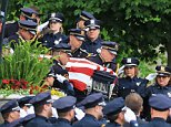 Police officers carry the casket of Omaha Police Officer Kerrie Orozco out of St. John's Catholic Church on the campus of Creighton University following funeral services in Omaha, Neb., Tuesday, May 26, 2015. Orozco was shot to death on May 20 while trying to arrest a fugitive who was in turn fatally shot by another officer. (AP Photo/Nati Harnik)