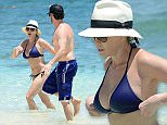EXCLUSIVE: **PREMIUM RATES APPLY**  Comedians Chelsea Handler and Josh Wolf cool off in the ocean in Bahamas. Chelsea Handler wearing a tiny blue bikini with white fedora hat went for a swim with her opening act friend Josh Wolf. The comedians were at the Atlantis, Paradise Island Memorial Day Weekend for Chelsea's new stand up act Uganda Be Kidding Me. Comedian Josh Wolf opened the show for the former late night host Chelsea Handler. Chelsea took the stage in Atlantis Ballroom wearing casual black shirt and pink jeans. Pics taken May 23rd.  Pictured: Chelsea Handler and Josh Wolf Ref: SPL1033602  260515   EXCLUSIVE Picture by: Jason Winslow / Splash News  Splash News and Pictures Los Angeles: 310-821-2666 New York: 212-619-2666 London: 870-934-2666 photodesk@splashnews.com