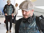 EXCLUSIVE: ***PREMIUM EXCLUSIVE RATES APPLY***  David Beckham arrives at JFK airport in NYC.  Pictured: David Beckham Ref: SPL1034452  240515   EXCLUSIVE Picture by: Ron Asadorian / Splash News  Splash News and Pictures Los Angeles: 310-821-2666 New York: 212-619-2666 London: 870-934-2666 photodesk@splashnews.com