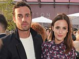 LONDON, ENGLAND - MAY 26:  James Dunmore (L) and Lucy Watson attend the Moet Ice Imperial Summer Party Pop Up Launch Event at Madison Rooftop Bar on May 26, 2015 in London, England.  (Photo by David M. Benett/Getty Images for Moet Ice Imperial)