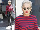 26.MAY.2015 - LONDON - UK RITA ORA IS SEEN LEAVING THE CAPITAL FM STUDIOS IN LONDON WEARING A BLACK PVC MINI SKIRT AND STRIPEY RED AND BLUE JUMPER. BYLINE MUST READ : XPOSUREPHOTOS.COM ***UK CLIENTS - PICTURES CONTAINING CHILDREN PLEASE PIXELATE FACE PRIOR TO PUBLICATION *** UK CLIENTS MUST CALL PRIOR TO TV OR ONLINE USAGE PLEASE TELEPHONE 0208 344 2007**