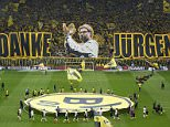 """Supporters hold up banners reading """"Thanks Juergen"""" to express their gratitude to Borussia Dortmund coach Juergen Klopp before his team's first division Bundesliga soccer match against Werder Bremen in Dortmund, Germany, May 23, 2015. REUTERS/Ina Fassbender DFL RULES TO LIMIT THE ONLINE USAGE DURING MATCH TIME TO 15 PICTURES PER GAME. IMAGE SEQUENCES TO SIMULATE VIDEO IS NOT ALLOWED AT ANY TIME. FOR FURTHER QUERIES PLEASE CONTACT DFL DIRECTLY AT + 49 69 650050"""