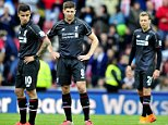 Liverpool's Brazilian midfielder Philippe Coutinho (L), Liverpool's English midfielder Steven Gerrard and Liverpool's Brazilian midfielder Lucas Leiva (R) wait to kick off after going 4-0 down during the English Premier League football match between Stoke City and Liverpool at the Britannia Stadium in Stoke-on-Trent, central England on May 24, 2015. Stoke won the game 6-1. AFP PHOTO / STEVE PARKIN RESTRICTED TO EDITORIAL USE. NO USE WITH UNAUTHORIZED AUDIO, VIDEO, DATA, FIXTURE LISTS, CLUB/LEAGUE LOGOS OR LIVE SERVICES. ONLINE IN-MATCH USE LIMITED TO 45 IMAGES, NO VIDEO EMULATION. NO USE IN BETTING, GAMES OR SINGLE CLUB/LEAGUE/PLAYER PUBLICATIONS.steve parkin/AFP/Getty Images