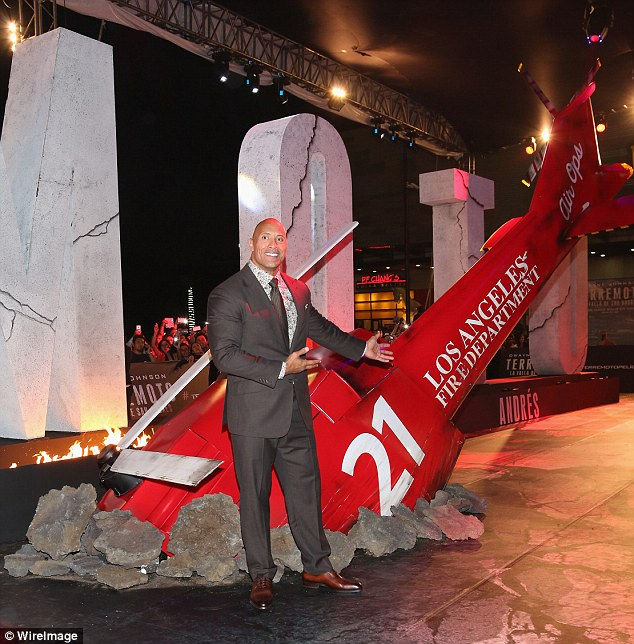 Cool props: At the premiere, Dwayne posed next to a helicopter that was made to look as though it had smashed into the ground