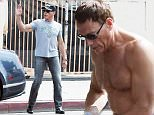 Picture Shows: Jean-Claude Van Damme  May 26, 2015    ** Min Web / Online Fee £150 For Set **    54 year old action star Jean-Claude Van Damme stops to change t-shirts, while out and about in Hollywood, California with some friends and his dog. After changing, a clearly hot Jean-Claude proceeded to wipe down his armpits in front of his pals.     ** Min Web / Online Fee £150 For Set **    Exclusive All Rounder  UK RIGHTS ONLY  Pictures by : FameFlynet UK © 2015  Tel : +44 (0)20 3551 5049  Email : info@fameflynet.uk.com