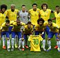 Marcelo holds the jersey of Neymar as Brazil's national team pose before their 2014 World Cup semi-finals against Germany at the Mineirao stadium in Belo Horizonte July 8, 2014.  REUTERS/Leonhard Foeger (BRAZIL  - Tags: SOCCER SPORT WORLD CUP)   - RTR3XO9H