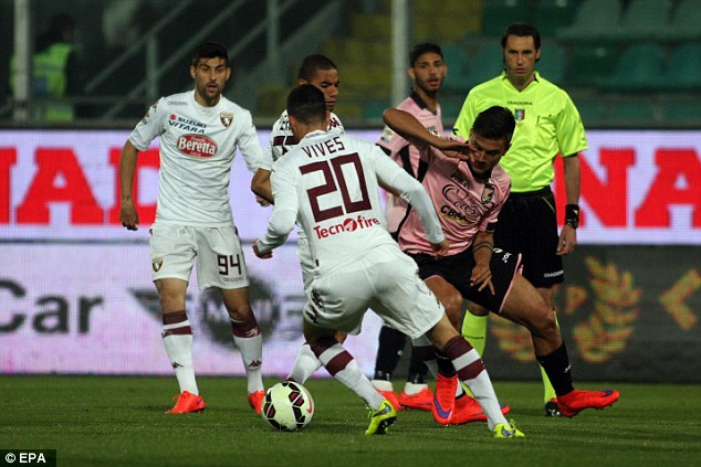 Paulo Dybala (right, in action against Torino) has scored 13 Serie A goals for Palermo this season