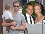 """UK CLIENTS MUST CREDIT: AKM-GSI ONLY\nEXCLUSIVE: Charlize Theron's ex boyfriend Stuart Townsend and his family were spotted today going for a stroll in Venice, the proud new dad carried his son while his partner pushed the stroller. Mr Townsend and Theron began dating after meeting on the set of 2002's 'Trapped' and lived together in L.A. and England. Before they called it quits, the couple said they always considered themselves married without an actual marriage. """"We didn't have a ceremony,"""" Townsend added. """"I don't need a certificate or the state or the church to say otherwise. So no there's no big official story on a wedding, but we are married. ... I consider her my wife and she considers me her husband.""""\n\nPictured: Stuart Townsend\nRef: SPL797992  070714   EXCLUSIVE\nPicture by: AKM-GSI / Splash News\n\nSplash News and Pictures\nLos Angeles: 310-821-2666\nNew York: 212-619-2666\nLondon: 870-934-2666\nphotodesk@splashnews."""