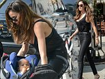 Australian supermodel Nicole Trunfio leaves her NYC hotel with her baby son Zion.....Pictured: Nicole Trunfio..Ref: SPL1032771  270515  ..Picture by: Splash News....Splash News and Pictures..Los Angeles: 310-821-2666..New York: 212-619-2666..London: 870-934-2666..photodesk@splashnews.com..