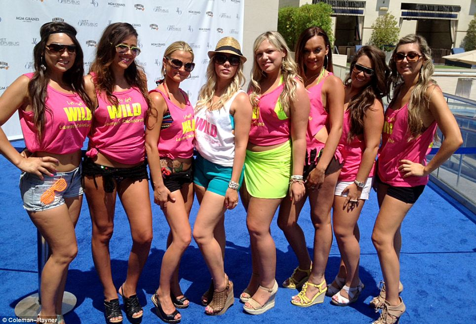 Bevvy of beauties: A host of girls line up at the Sin City pool party
