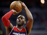 FILE - In this March 25, 2015, file photo, Washington Wizards guard John Wall shoots a free throw during an NBA basketball game against the Indiana Pacers in Washington. Police say Wall was kicked off a flight in Las Vegas on Tuesday, May 26, 2015, after a disturbance was reported. Las Vegas police said Friday that Wall was with a group of people on an American Airlines flight around 2:30 p.m. on Tuesday. Police say one of the people with Wall got into a verbal fight with another passenger who was unrelated to the group. Police say there were no charges or arrests. (AP Photo/Alex Brandon, File)
