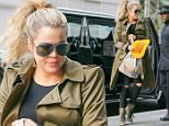 TV Personality KhloÈ Kardashian is spotted holding a yellow hat and going makeup free as she arrives at her hotel in New York City, NY on May 29, 2015.\n\nPictured: KhloÈ Kardashian\nRef: SPL1039451  290515  \nPicture by: Felipe Ramales / Splash News\n\nSplash News and Pictures\nLos Angeles: 310-821-2666\nNew York: 212-619-2666\nLondon: 870-934-2666\nphotodesk@splashnews.com\n