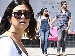 Kourtney Kardashian and Scott Disick got out for some casual Friday furniture shopping.  Kourtney went with overalls and massive platform boots, while Scott wore a thick beard and a plaid blue shirt, in North Hollywood.  May 29, 2015 X17online.com