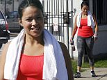 137915, EXCLUSIVE: 'Jane The Virgin' star Gina Rodriguez looks pretty in a tank top and rainbow hand wraps as she leaves a boxing gym in New Orleans. Later in the day she took her dog for a walk while she FaceTimed a friend and got coffee. New Orleans, Louisiana - Friday, May 29, 2015. Photograph: © PacificCoastNews. Los Angeles Office: +1 310.822.0419 sales@pacificcoastnews.com FEE MUST BE AGREED PRIOR TO USAGE