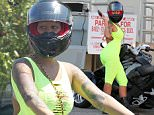 Picture Shows: Amber Rose  May 28, 2015    Model Amber Rose and a friend out for a cruise on her Can-Am Spyder in Los Angeles, California. Amber was rocking a skin tight neon yellow body suit while out for a cruise.    Non Exclusive  UK RIGHTS ONLY    Pictures by : FameFlynet UK © 2015  Tel : +44 (0)20 3551 5049  Email : info@fameflynet.uk.com