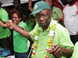 Shameless: Former FIFA Vice President Jack Warner (second right) dances with supporters at a political rally organised by his Independent Liberal Party in Chaguanas, in Trinidad and Tobago, hours after leaving prison in an ambulance complaining of exhaustion while facing eight charges in the U.S. corruption case