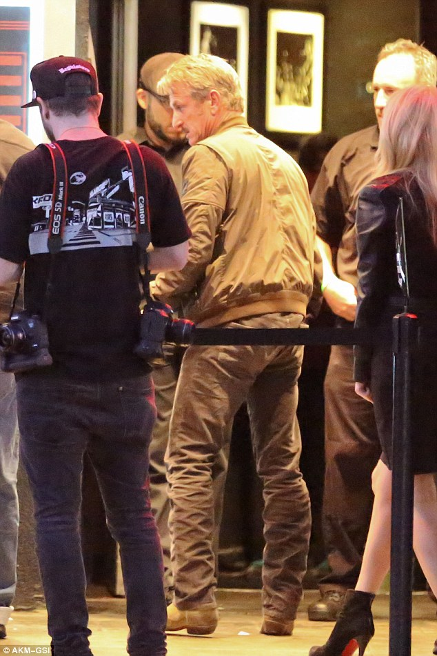 Made for walkin': Sean Penn casually wore cowboy boots as he waited in line for the U2 show at The Roxy in Los Angeles Thursday night
