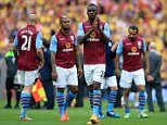 Aston Villa's Christian Benteke (centre) applauds the fans as he stands dejected with team-mates after the final whistle during the FA Cup Final at Wembley Stadium, London. PRESS ASSOCIATION Photo. Picture date: Saturday May 30, 2015. See PA Story SOCCER FA Cup. Photo credit should read: Nick Potts/PA Wire. RESTRICTIONS: Editorial use only. Maximum 45 images during a match. No video emulation or promotion as 'live'. No use in games, competitions, merchandise, betting or single club/player services. No use with unofficial audio, video, data, fixture