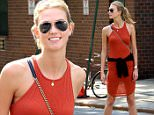 May 29, 2015: Model Karlie Kloss wears an orange summer dress as walks in the West Village section of New York City.\nMandatory Credit: Philip Vaughan/ACE/INFphoto.com Ref: infusny-220