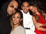 HOLLYWOOD, CA - OCTOBER 20:  (EXCLUSIVE COVERAGE)  Recording artist Chris Brown (L) and model Karrueche Tran attend Teyana Taylor's VII listening event presented by Def Jam, GOOD Music and MVD Inc at Siren Studios on October 20, 2014 in Hollywood, California.  (Photo by Chelsea Lauren/WireImage)