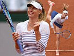 Russia's Maria Sharapova serves to Australia's Samantha Stosur during the women's third round at the Roland Garros 2015 French Tennis Open in Paris on May 29, 2015.  AFP PHOTO / PASCAL GUYOTPASCAL GUYOT/AFP/Getty Images