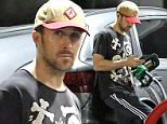 EXCLUSIVE TO INF.\nMay 29, 2015: Ryan Gosling checks his phone while filling his tank at a gas station in Los Angeles, California.\nMandatory Credit: Chiva/INFphoto.com\nRef: infusla-275