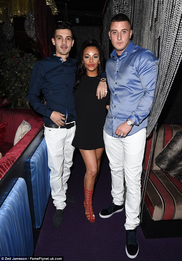 Fan-tastic! Chelsee poses with two male pals she got chatting to at the London venue