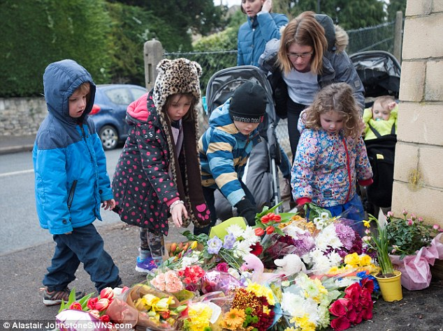 Local families laid flowers and toys at the scene of the accident today, with some paying tribute to little Mitzi